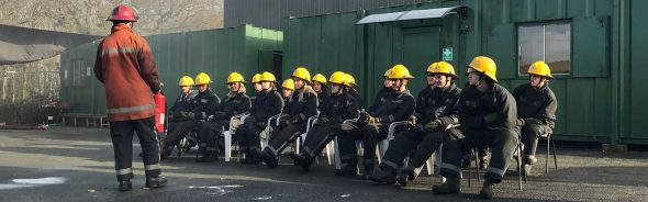 STCW Fire safety course in action the students look on as the instructor talks though fire safety on board