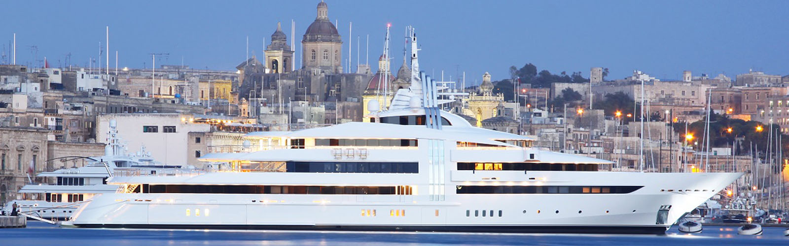 A white superyacht in port