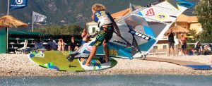 A young man shows great skill on a windsurfing board