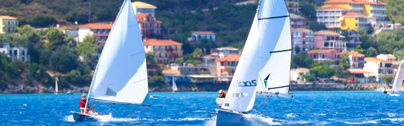 Image of 2 people dinghy sailing at flying fish in greece