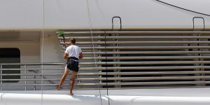 Deckhand at work on a superyacht
