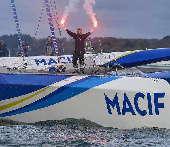 French sailor breaks record for fastest solo trip around the world